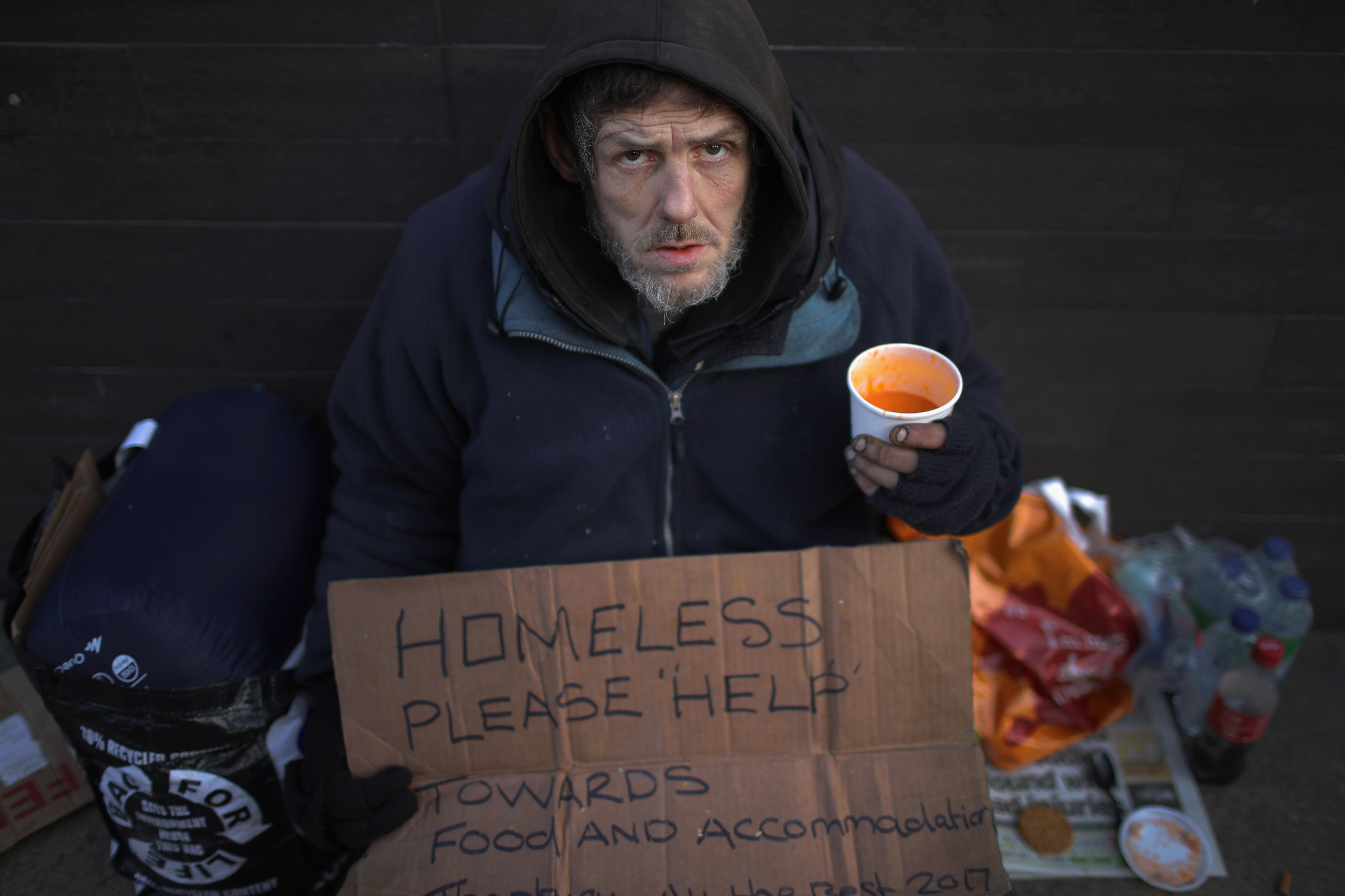 MANCHESTER, ENGLAND - JANUARY 13:  A homeless man begs for small change on the streets of Manchester on January 13, 2017 in Manchester, United Kingdom. Many homeless people are spending the night on the streets in freezing temperatures as the Met Office c