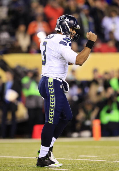 EAST RUTHERFORD, NJ - FEBRUARY 02: Quarterback Russell Wilson #3 of the Seattle Seahawks celebrates a touchdown during the fourth quarter of Super Bowl XLVIII at MetLife Stadium on February 2, 2014 in East Rutherford, New Jersey.  (Photo by Jamie Squire/G