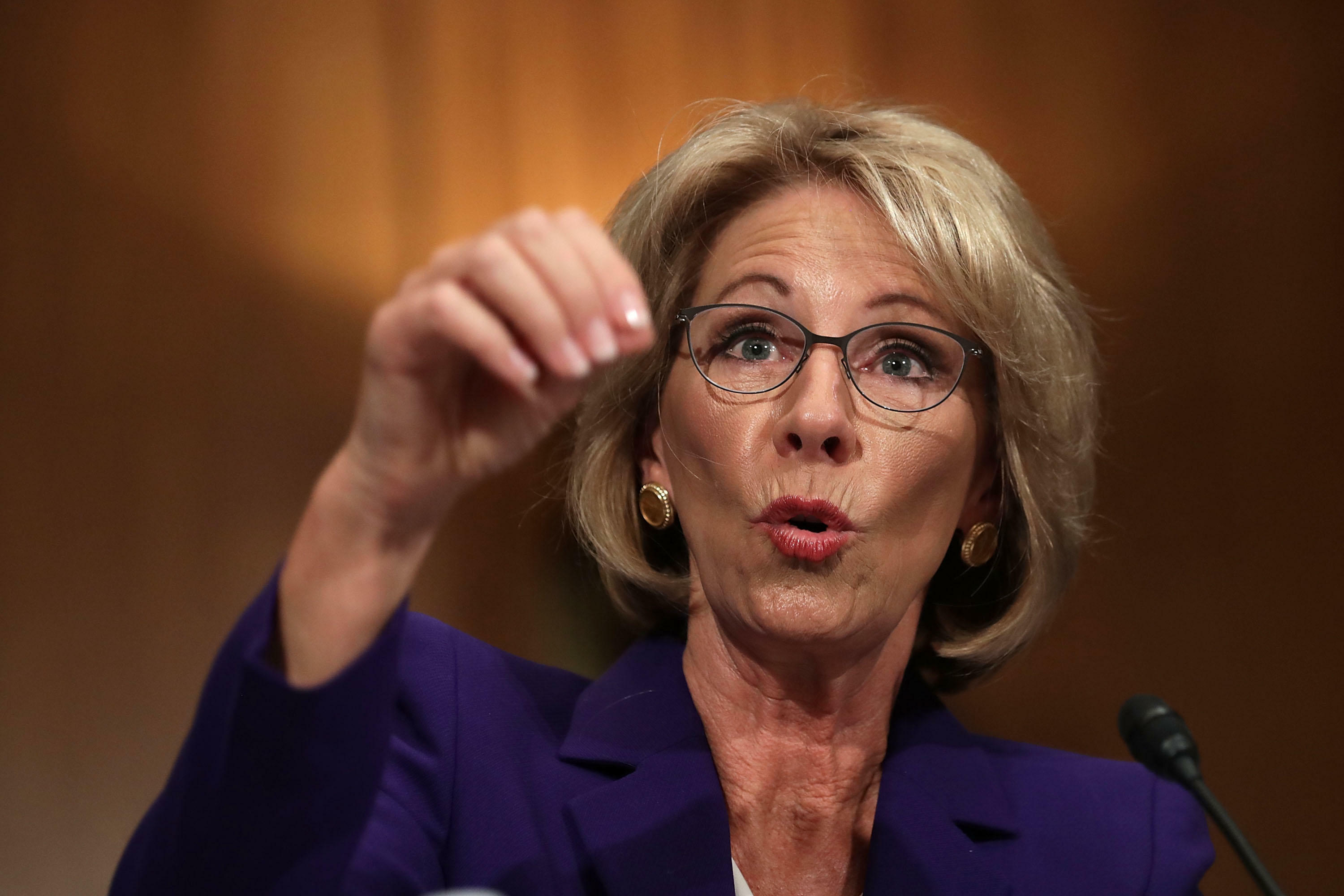WASHINGTON, DC - JANUARY 17:  Betsy DeVos, President-elect Donald Trump's pick to be the next Secretary of Education, testifies during her confirmation hearing before the Senate Health, Education, Labor and Pensions Committee in the Dirksen Senate Office