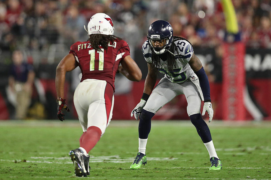 GLENDALE, AZ - OCTOBER 23:  Cornerback Richard Sherman #25 of the Seattle Seahawks defends wide receiver Larry Fitzgerald #11 of the Arizona Cardinals during the NFL game at the University of Phoenix Stadium on October 23, 2016 in Glendale, Arizona.  (Photo by Christian Petersen/Getty Images)