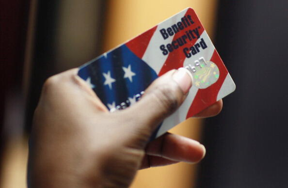 NEW YORK - FEBRUARY 10:  Kethia Dorelus a social worker with the Cooperative Feeding Program displays a Federal food stamps card that is used to purchase food on February 10, 2011 in Fort Lauderdale, Florida. Recent statistics show that nationwide, one in