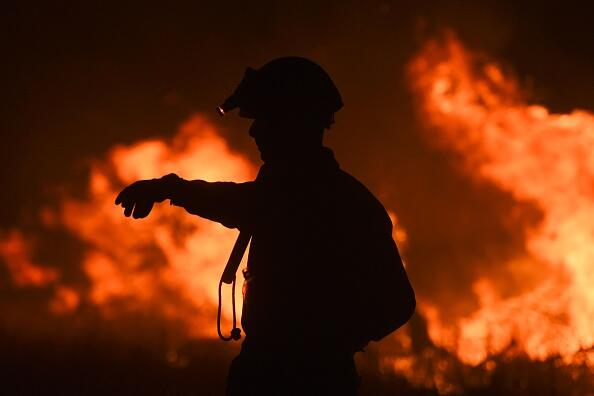 A fireman gestures while fighting a wildfire near La Adela in La Pampa Province on January 5, 2017.  Firefighters in Argentina said on January 5 they were bringing under control three wildfires that have devastated nearly a million hectares (2.5 million acres) of the country's famous pampas, or plains. / AFP / Eitan ABRAMOVICH        (Photo credit should read EITAN ABRAMOVICH/AFP/Getty Images)