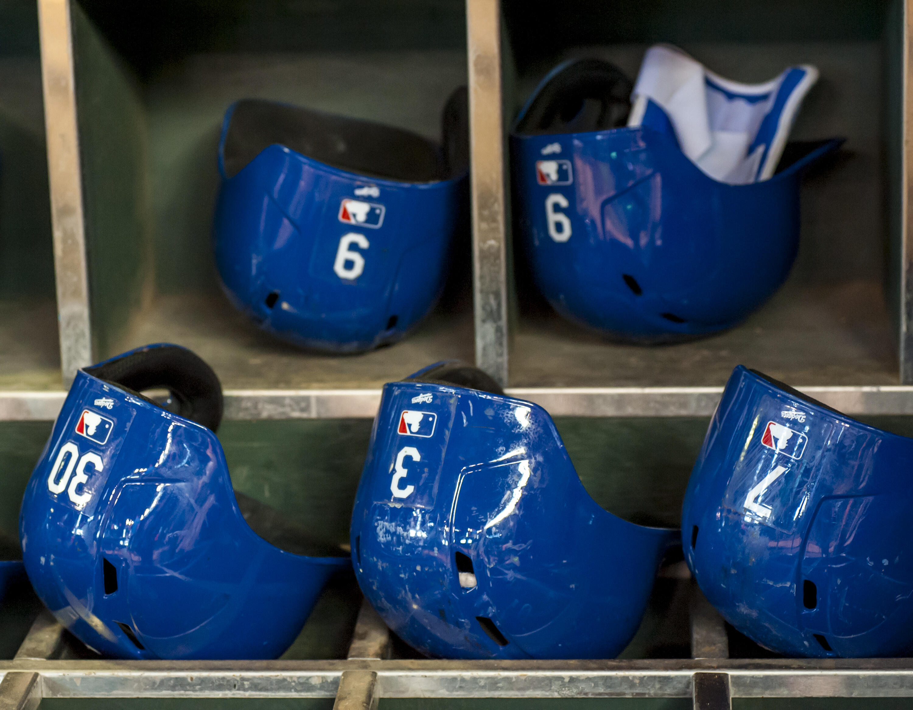 PHOENIX, AZ - SEPTEMBER 13: Helmet rack of the Los Angeles Dodgers before a MLB game against the Arizona Diamondbacks on September 13, 2015 at Chase Field in Phoenix, Arizona. (Photo by Darin Wallentine/Getty Images)