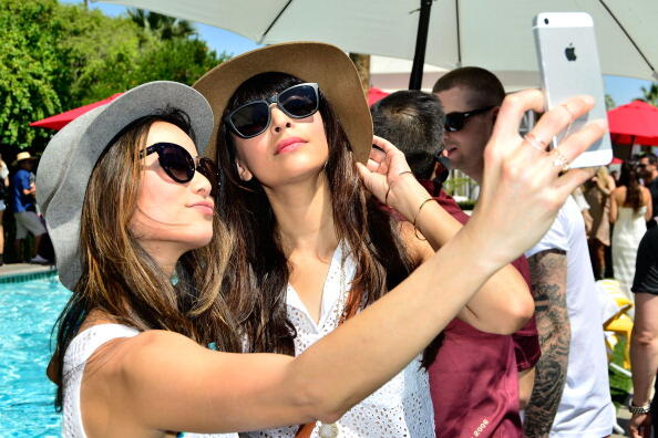 PALM SPRINGS, CA - APRIL 12: Jamie Chung and Hannah Simone pose for a selfie at the GUESS Hotel at the Viceroy Palm Springs on April 12, 2014 in Palm Springs, California.  (Photo by Jerod Harris/Getty Images for GUESS)