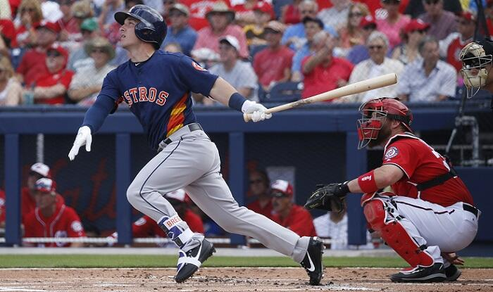 WEST PALM BEACH, FL - FEBRUARY 28: Alex Bregman #2 of the Houston Astros hits the ball against the Washington Nationals in the first inning during a spring training game at The Ballpark of the Palm Beaches on February 28, 2017 in West Palm Beach, Florida.