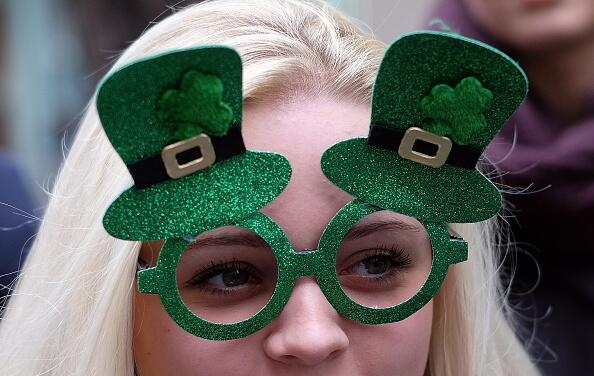 A girl watches marchers during the St Patrick's Day parade in New York on March 17, 2015. AFP PHOTO/JEWEL SAMAD        (Photo credit should read JEWEL SAMAD/AFP/Getty Images)
