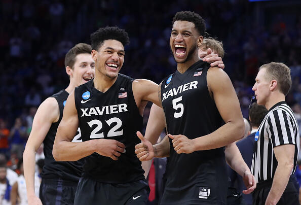 ORLANDO, FL - MARCH 18:  Kaiser Gates #22 and Trevon Bluiett #5 of the Xavier Musketeers celebrate their 91-66 over the Florida State Seminoles to advance during the second round of the 2017 NCAA Men's Basketball Tournament at the Amway Center on March 18, 2017 in Orlando, Florida.  (Photo by Rob Carr/Getty Images)