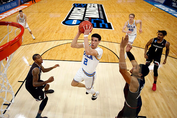 SACRAMENTO, CA - MARCH 19:  Lonzo Ball #2 of the UCLA Bruins drives to the basket as Kyle Washington #24 of the Cincinnati Bearcats defends during the second round of the NCAA Basketball Tournament at Golden 1 Center on March 19, 2017 in Sacramento, California.  (Photo by Jamie Squire/Getty Images)