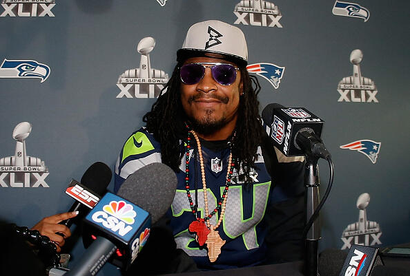CHANDLER, AZ - JANUARY 28:  Running back Marshawn Lynch #24 of the Seattle Seahawks speaks during a Super Bowl XLIX media availability at the Arizona Grand Hotel on January 28, 2015 in Chandler, Arizona.  (Photo by Christian Petersen/Getty Images)