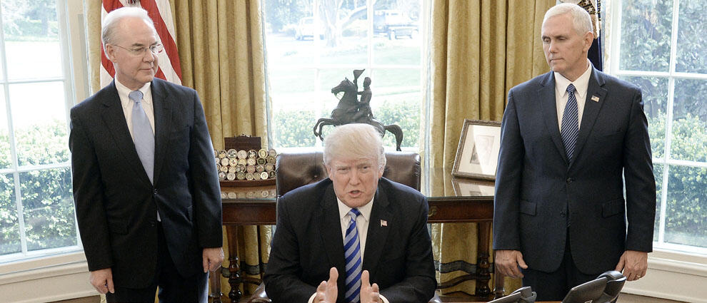 WASHINGTON, DC - MARCH 24: U.S. President Donald Trump reacts with HHS Secretary Tom Price (L) and Vice President Mike Pence (R) after Republicans abruptly pulled their health care bill from the House floor, in the Oval Office of  the White House on March