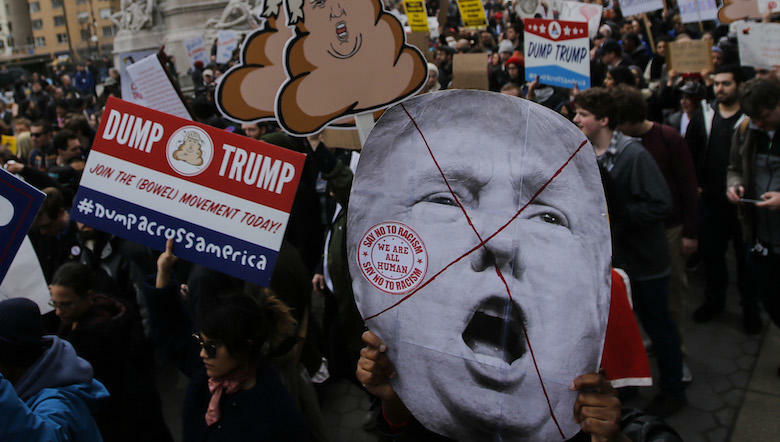 NEW YORK, NY - MARCH 19: People take part in a protest against Republican presidential candidate Donald Trump, on March 19, 2016 in New York City. People protest against Trump's policies which threaten the Immigration system and many of the Latino, Black,