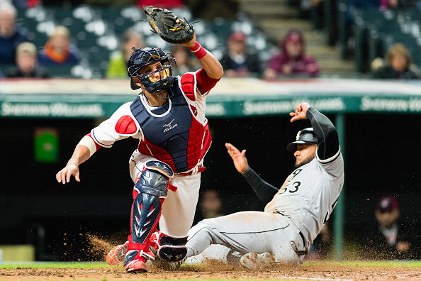 CLEVELAND, OH - APRIL 13: Catcher Yan Gomes #7 of the Cleveland Indians makes the catch as Melky Cabrera #53 of the Chicago White Sox scores during the eighth inning at Progressive Field on April 13, 2017 in Cleveland, Ohio. (Photo by Jason Miller/Getty Images)