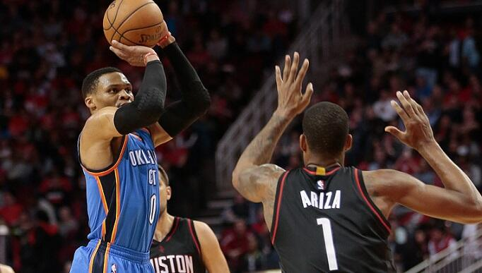 HOUSTON, TX - JANUARY 05:  Russell Westbrook #0 of the Oklahoma City Thunder shoots a three-point shot over Trevor Ariza #1 of the Houston Rockets at Toyota Center on January 5, 2017 in Houston, Texas. NOTE TO USER: User expressly acknowledges and agrees