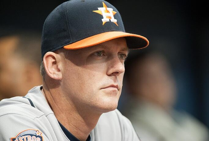 ST. PETERSBURG, FL - JULY 11: A.J. Hinch #14, Manager of the Houston Astros looks on from the dugout in the first inning against the Tampa Bay Rays on July 11, 2015 at Tropicana Field in St. Petersburg, Florida. (Photo by Cliff McBride/Getty Images)