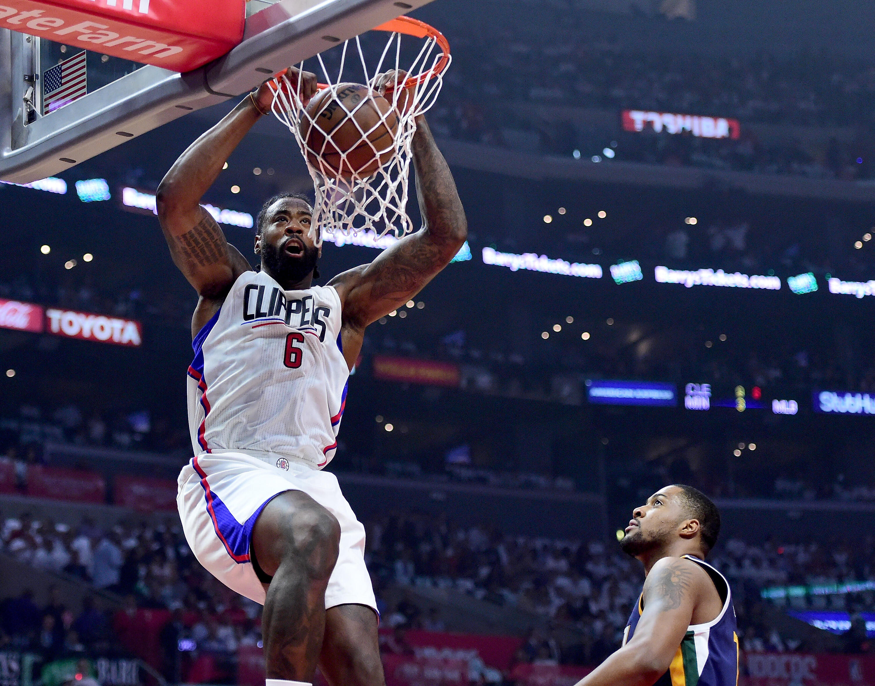 LOS ANGELES, CA - APRIL 18:  DeAndre Jordan #6 of the LA Clippers dunks in front of Derrick Favors #15 of the Utah Jazz during the first half in Game Two of the Western Conference Quarterfinals during the 2017 NBA Playoffs at Staples Center on April 18, 2