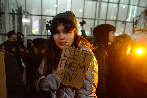 NEW YORK, NY - JANUARY 28: Protestors rally during a demonstration against the new immigration ban issued by President Donald Trump at John F. Kennedy International Airport on January 28, 2017 in New York City. President Trump signed the controversial executive order that halted refugees and residents from predominantly Muslim countries from entering the United States. (Photo by Stephanie Keith/Getty Images)