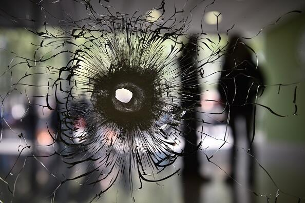 A bullet impact is pictured on a window in the entrance hall of a building on the Champs Elysees avenue in Paris, on April 21, 2017 a day after a gunman opened fire on police on the avenue, killing a policeman and wounding two others in an attack claimed by the Islamic State group just days before the first round of the presidential election. / AFP PHOTO / PHILIPPE LOPEZ        (Photo credit should read PHILIPPE LOPEZ/AFP/Getty Images)