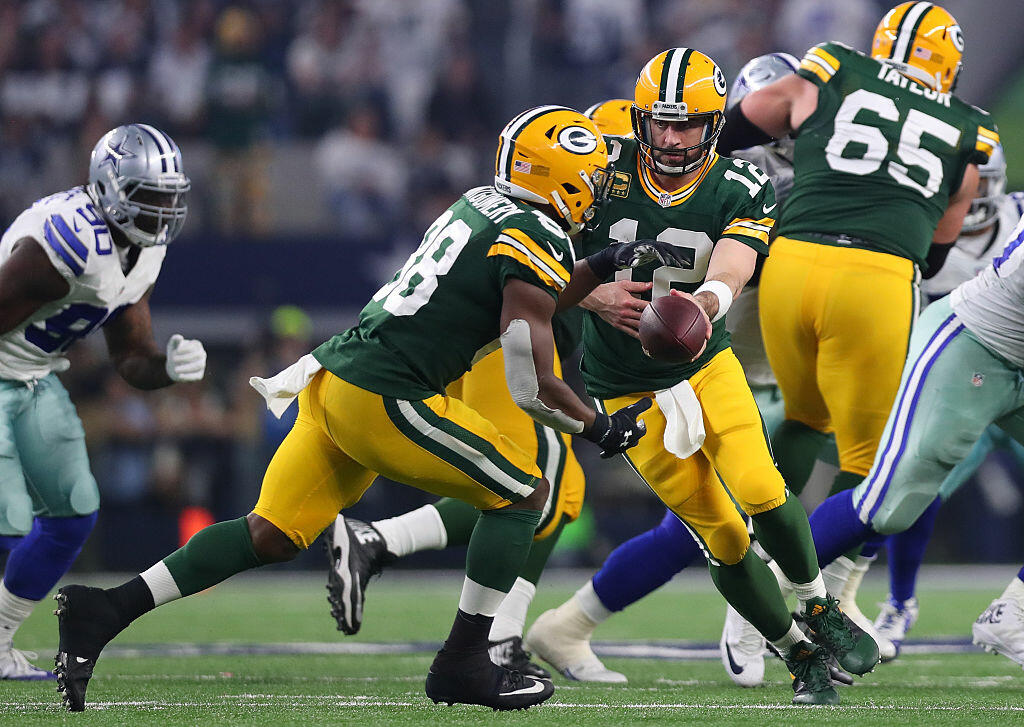 ARLINGTON, TX - JANUARY 15:  Aaron Rodgers #12 of the Green Bay Packers hands off to Ty Montgomery #88 during the third quarter in the NFC Divisional Playoff game at AT&T Stadium on January 15, 2017 in Arlington, Texas.  (Photo by Tom Pennington/Getty Images)