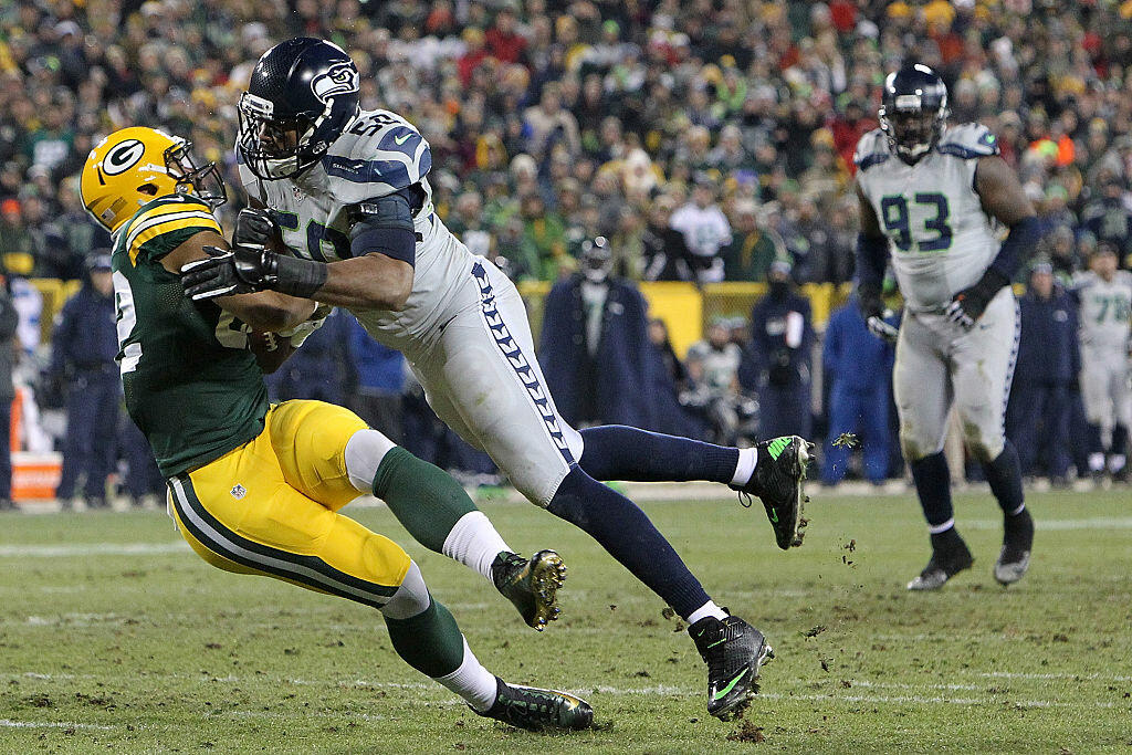 GREEN BAY, WI - DECEMBER 11:  K.J. Wright #50 of the Seattle Seahawks tackles Richard Rodgers #82 of the Green Bay Packers during the second half of a game at Lambeau Field on December 11, 2016 in Green Bay, Wisconsin.  (Photo by Dylan Buell/Getty Images)
