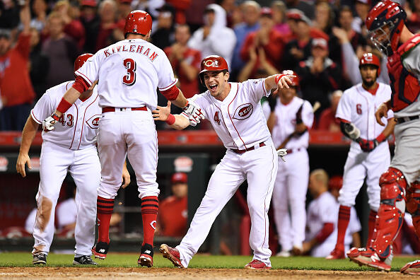CINCINNATI, OH - JUNE 7:  Scooter Gennett #4 of the Cincinnati Reds celebrates with Patrick Kivlehan #3 of the Cincinnati Reds at home plate after Kivlehan hit a three-run home run in the seventh inning against the St. Louis Cardinals at Great American Ball Park on June 7, 2017 in Cincinnati, Ohio. Cincinnati defeated St. Louis 6-4.  (Photo by Jamie Sabau/Getty Images)