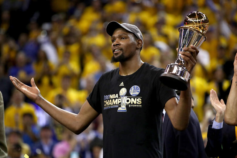 OAKLAND, CA - JUNE 12:  Kevin Durant #35 of the Golden State Warriors celebrates after being named Bill Russell NBA Finals Most Valuable Player after defeating the Cleveland Cavaliers 129-120 in Game 5 to win the 2017 NBA Finals at ORACLE Arena on June 12
