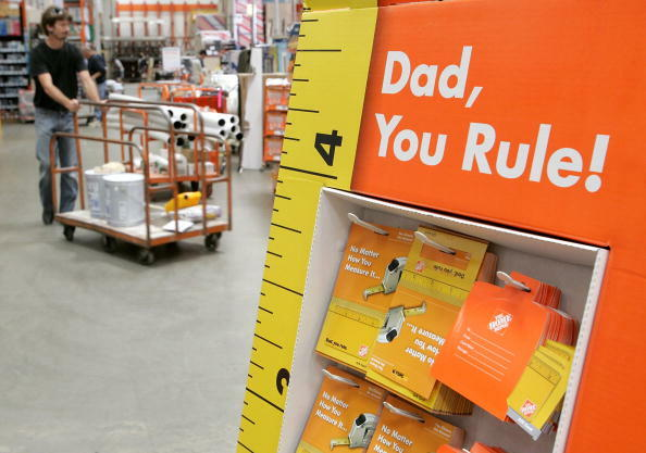 SAN RAFAEL, CA - JUNE 15: A Home Depot customer walks by a display of Father's Day gift cards at a Home Depot store on June 15, 2006 in San Rafael, California. Retail outlets are promoting Father's day gift buying in hopes that the holiday will become mor