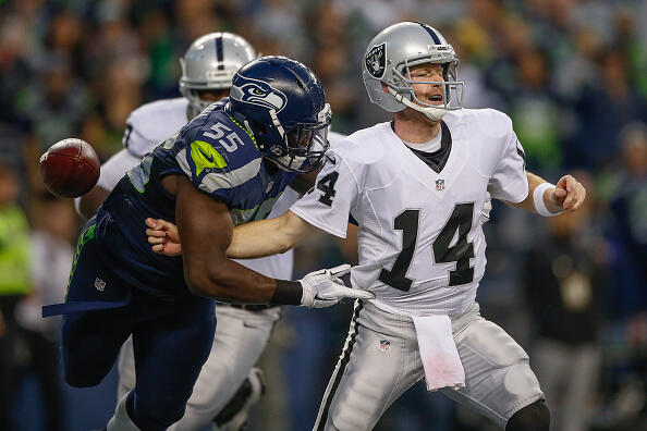 SEATTLE, WA - SEPTEMBER 03:  Quarterback Matt McGloin #14 of the Oakland Raiders is sacked in the end zone by defensive end Frank Clark #55 of the Seattle Seahawks at CenturyLink Field on September 3, 2015 in Seattle, Washington. The Seahawks recovered the fumble on the play resulting in a touchdown.  (Photo by Otto Greule Jr/Getty Images)
