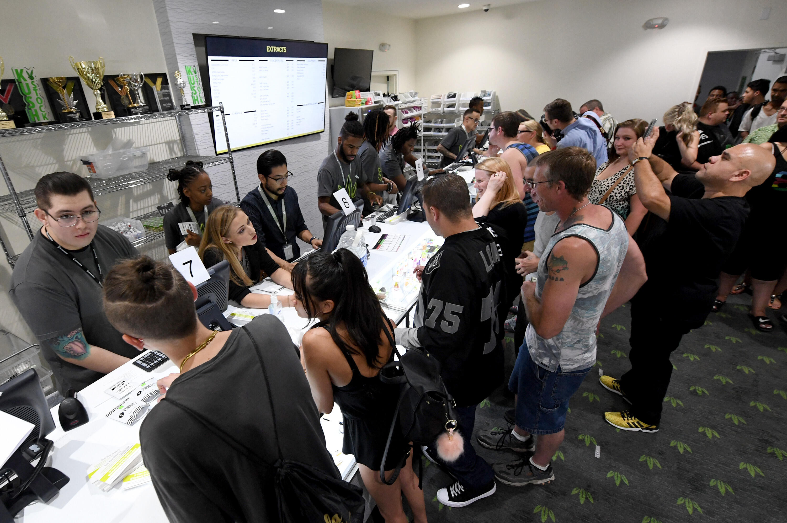 LAS VEGAS, NV - JULY 01:  Customers buy cannabis products at Essence Vegas Cannabis Dispensary after the start of recreational marijuana sales began on July 1, 2017 in Las Vegas, Nevada. Nevada joins seven other states allowing recreational marijuana use