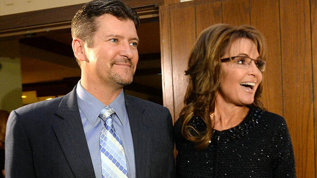 Sarah Palin, right, former Governor of Alaska, and her husband, Todd, arrive at the Grove Park Inn for a celebration of Billy Graham's 95th birthday in Asheville, N.C., on Thursday, Nov. 7, 2013. (Todd Sumlin/Charlotte Observer/Tribune News Service via Getty Images)