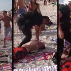 WATCH: Cop Man Handles Drunk Dudes At Beach