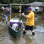 'Donations for Volunteers' Are Being Eaten in Front of Hungry Louisiana Flood Victims