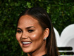 Chrissy Teigen Claps Back At Mom Shamer Who Criticizes Her Holding Baby Luna