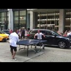 Why Is Usher Stopping Traffic To Play Ping Pong In The Street?