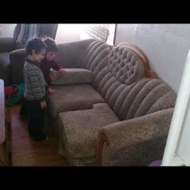 Kids Figuring Out How to Put Cushions on Couch Are Adorably Frustrating