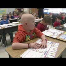 First Grader shaved head to support his friend.