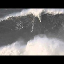 Surfer breaks World record by surfing an 80 foot wave in Portugal