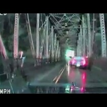 Woman jumps off bridge after high-speed police chase!