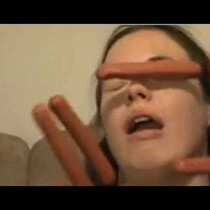 30 Seconds of a Sleeping Woman Getting Hit in the Face with Hot Dogs