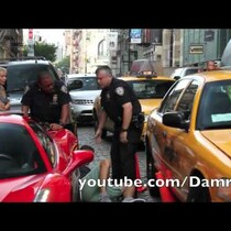 Jerk in a Ferrari runs over a cop's foot