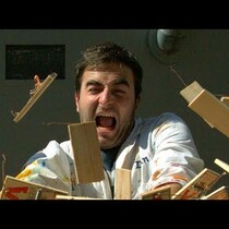Dude Sets Off 150 Mouse Traps With His Hands in SUPER Slo Motion