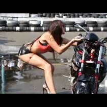 FAIL: HOT CHICK WASHING A MOTORCYCLE... WAIIIIIT FOR IT!