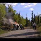 Hero Cop & Bystanders Pull Man From Burning SUV