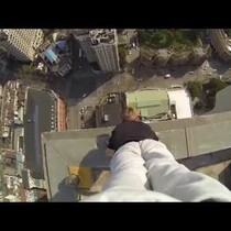 WATCH:  Look mom, no feet!  Dude does a handstand 40 stories up.