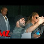 Jay Z pushes fan out of the way to protect Beyonce!