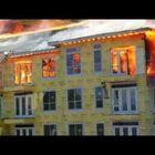 Building Burns While Construction Worker Jumps Floor to Floor