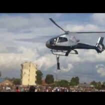 VIDEO: GUY HANGS FROM HELICOPTER