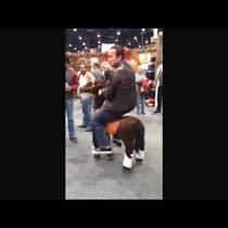 WATCH: Arnold Schwarzenegger riding a..... toy pony?