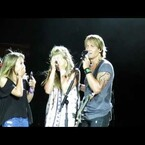 Keith Urban brings fans on stage and they bring him a gift...