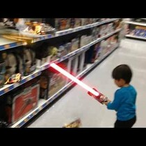 Action Movie Kid - with a lightsaber!