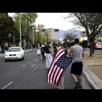 VIDEO: A Marine and Soldier Take Back the Flag from Protester